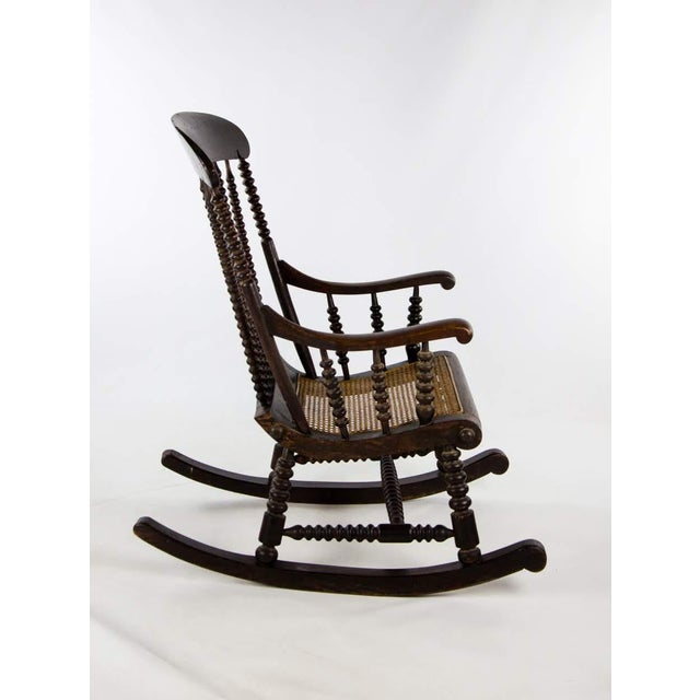 Rustic Late 19th Century Vintage Victorian Bobbin Turned and Caned Seat Rocking Chair For Sale - Image 3 of 13