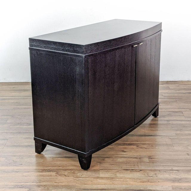 The cabinet fits 14 bottles of wine, a dozen glasses, as well as room for bar mixes and accessories. Brand is Crate &...