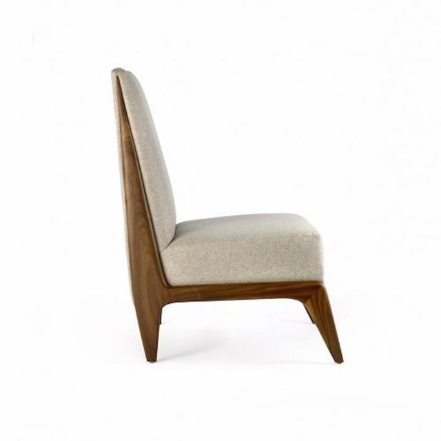 The Frederique slipper chair by Studio Van den Akker is available in a variety of woods, stains and finishes.