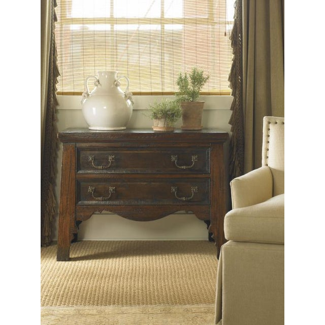 This piece is available only as shown, and will ship in 2-3 weeks. An elegant demilune nightstand crafted of maple solids...
