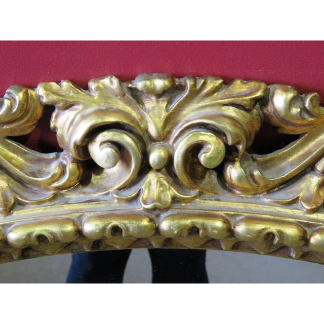 Gilt carved oval mirror. Light wear to gilt.
