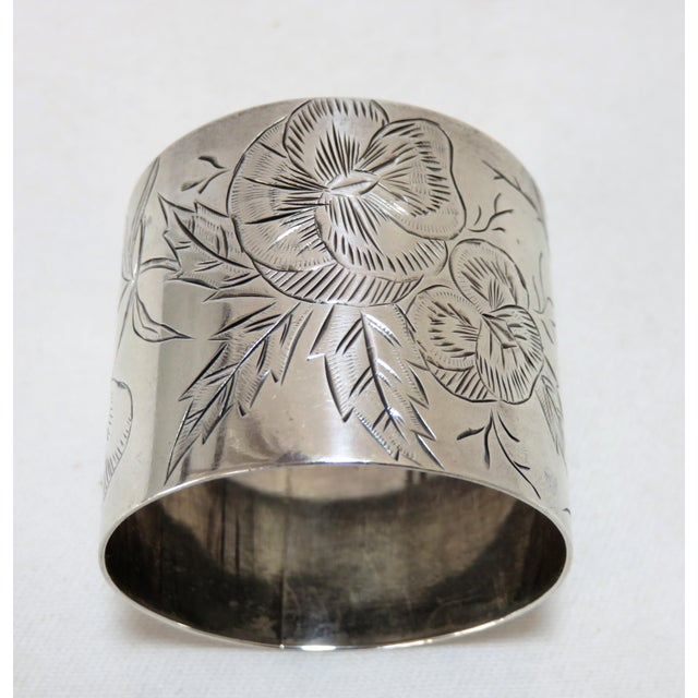Large Size Antique American Victorian sterling silver napkin ring. Hand Engraved floral design done in the Bright Cut...