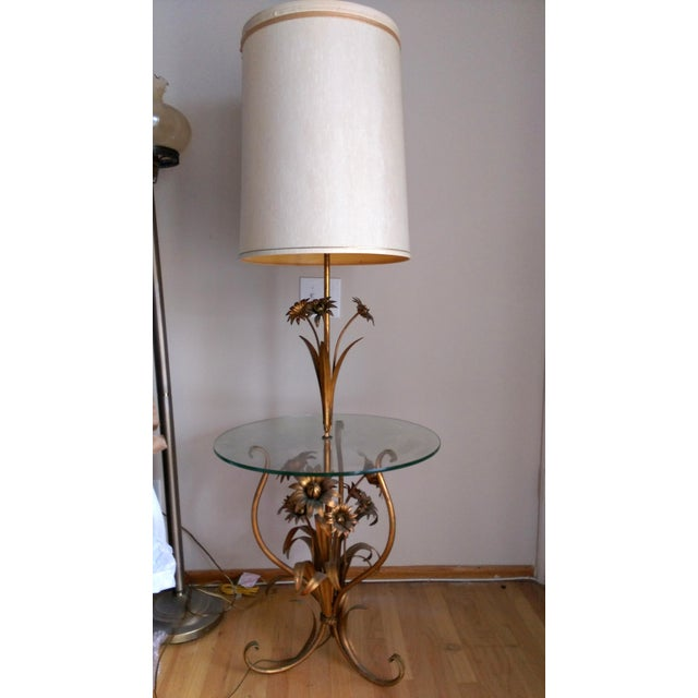 A Toleware floor table lamp with a gilded flowers design and original shade. Wired and in working condition. There are a...