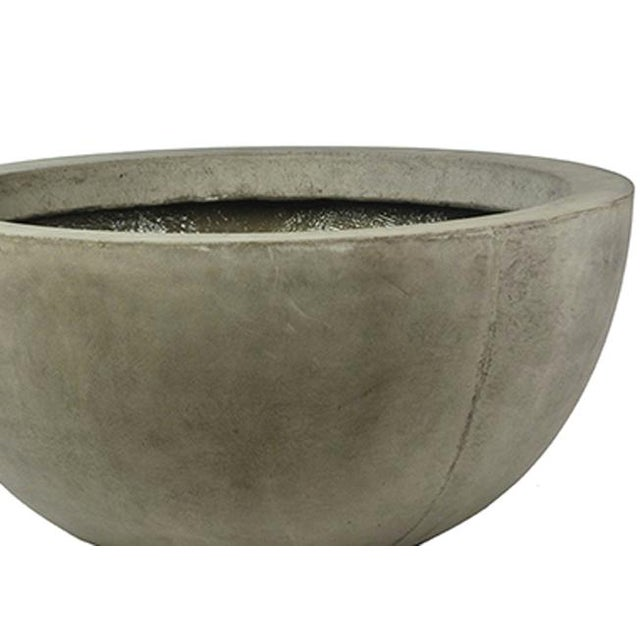 Modern bowl shaped lightweight concrete planters in a set of three, including one small, medium, and large planter. These...