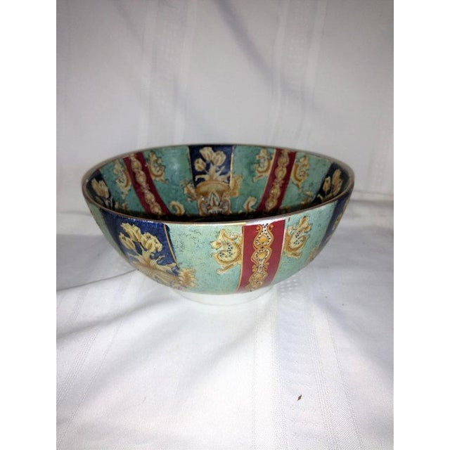 Large colorful and detailed antique Chinese export hand painted enamel porcelain bowl with beautiful panels. Roses in urns...