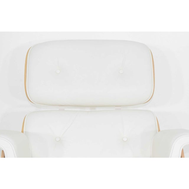 Less than 2 years old. A Charles & Ray Eames lounge chair and ottoman in white MCL leather and white ash. Purchased new...