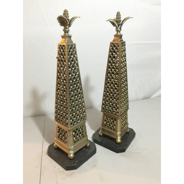 Fabulous, antique silver metal obelisks with metal chain details and decorative tops. Set on black marble bases. By John...