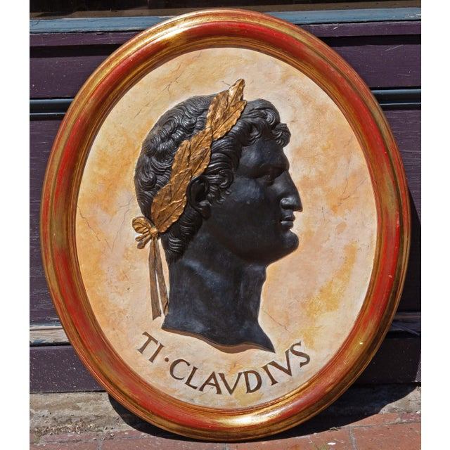 Hand painted and gilt classical plaques of Roman emperors. Set of four. In quality giltwood frames. Plaques are cast...