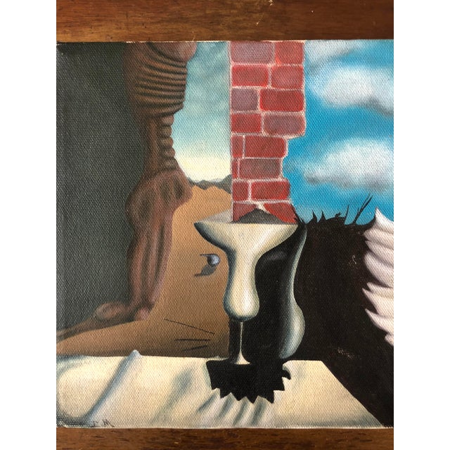 Small surrealist painting on canvas. Initialed lower left corner. Unframed.