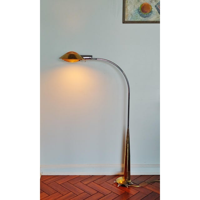 Designed in 1978 by Cedric Hartman, this 91CO floor lamp features a brass shade and base with chrome steel shaft....