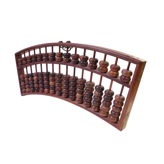 This is a Chinese rosewood material fan shape abacus. The natural rosewood color and pattern is very pretty. The fan shape...