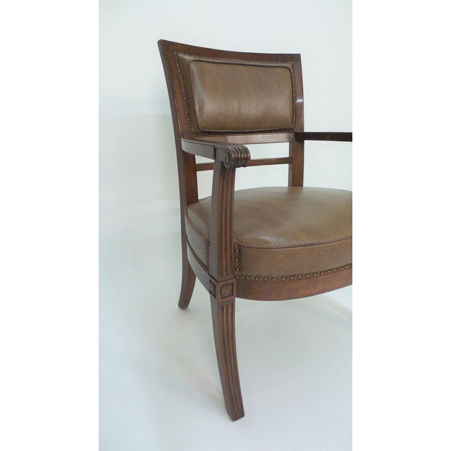 """An Empire style armchair inspired by a design by master chairmaker J.B.B. Demay, shown with """"en tableau"""" boxed leather..."""