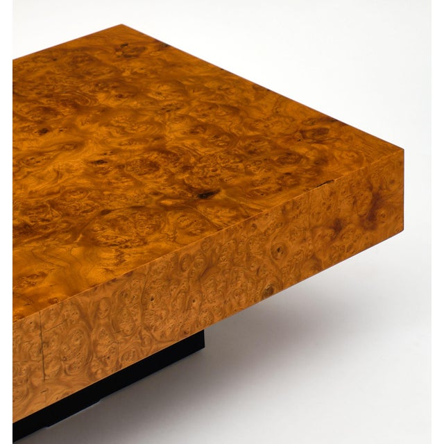 A fine French burl ash mid-century coffee table. This vintage piece has a black lacquered wood base and burled ash top....