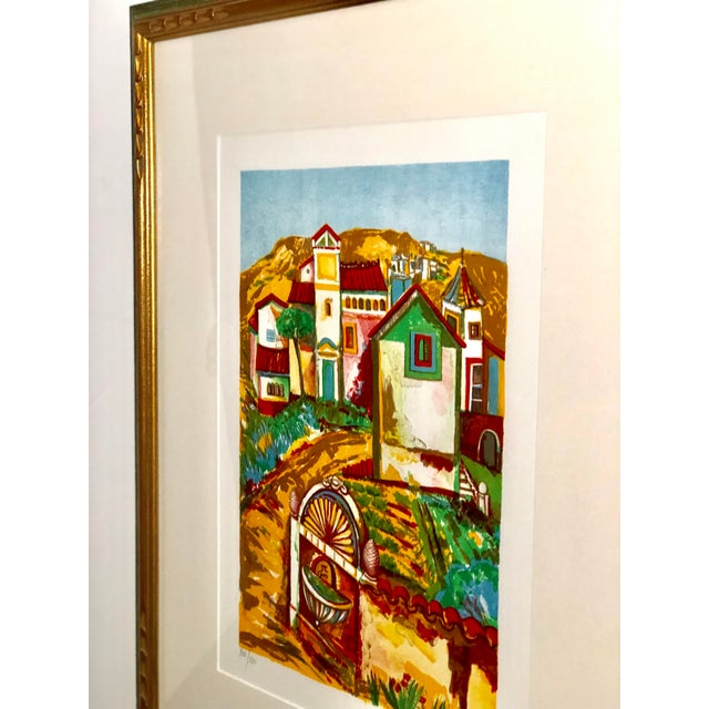 Midcentury signed and numbered print in bright retro hues of turquoise, red, green, and yellow. The work is in an...