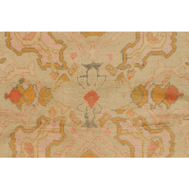 Stunning early 20th century Full Pile Excellent Condition Pink colored antique oushak rug. Created in Western Turkey,...