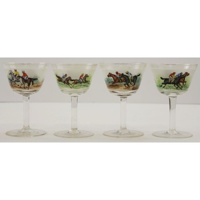 "A set of hand painted jockey cordial glasses. Dimensions: 4""H x 2 5/8""D"
