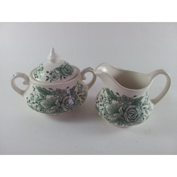 Like new English Ironstone KEW green cream and sugar. Produced in the1980's with a lovely moss green rose motif. Sugar is...