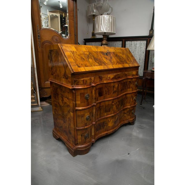 This exquisite Italian Rococo burl walnut desk has a slant front opening to reveal a central compartment with door flanked...