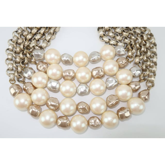 615c8073b10 This Yves Saint Laurent multi-strand necklace is resplendent with three