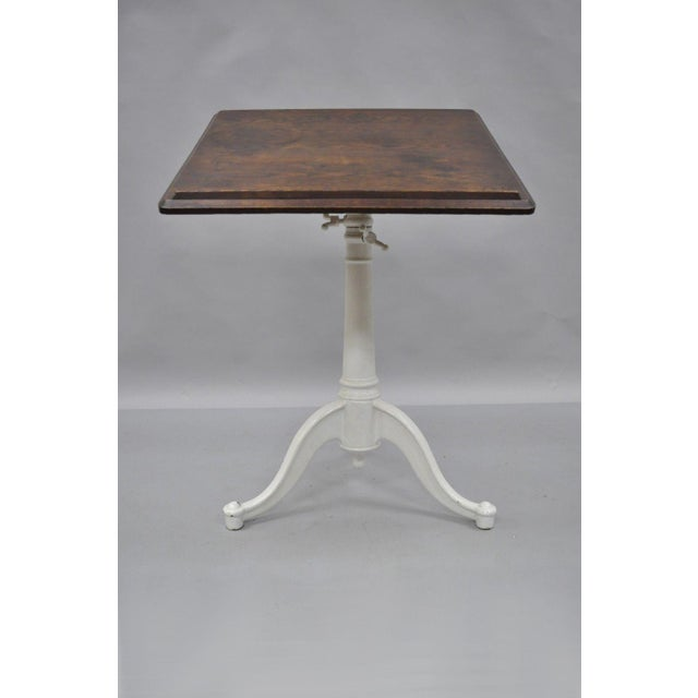 Antique Cast Iron & Wood Small Drafting Work Table by Eugene Dietzgen. Item features cast iron tripod base, Solid wood...
