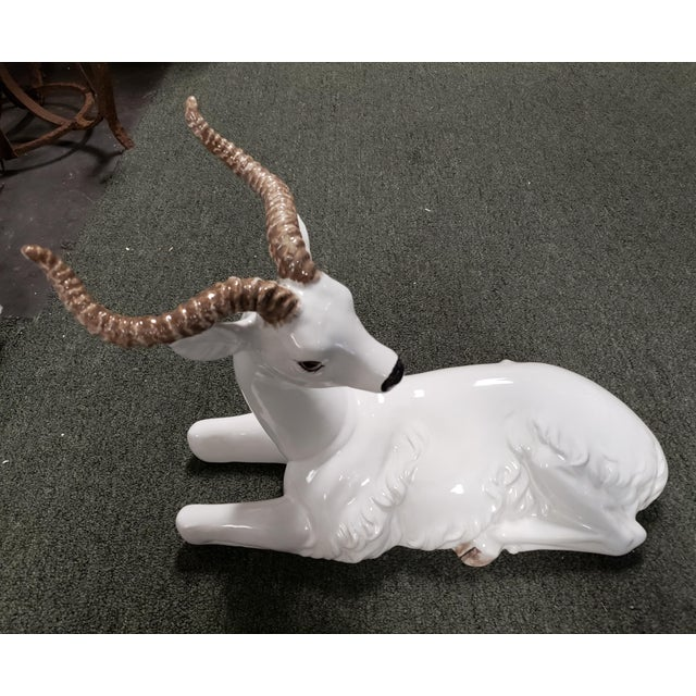"""Up for sale is a Mid 20th Century Italian Ceramic Recumbent Gazelle Sculpture! It measures 12 1/8"""" tall, 16"""" long, and 6..."""