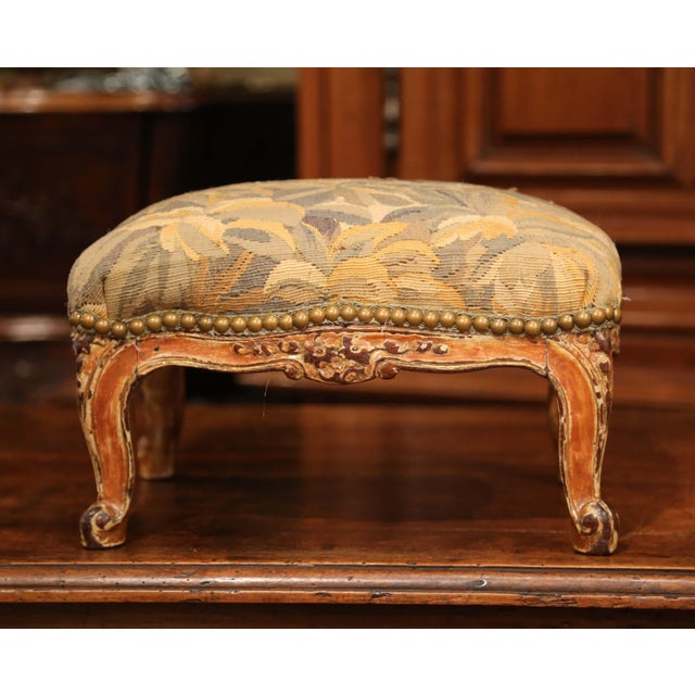 This elegant, antique Louis XV footstool was crafted in France, circa 1850. The carved, rectangular footrest sits on four...