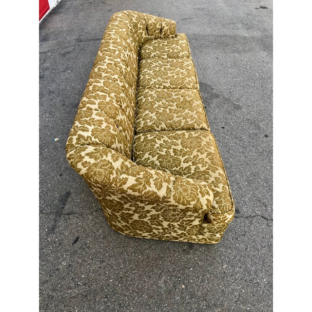 This single row, button-tufted, 9+ft sofa, with softly sloping, wrap around, cabriolet arms, was purchased back in 1968,...