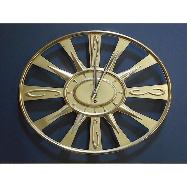 Fabulous Mid-Century Modern Phinney Walker wall clock with key.\ This is an eight day brass clock witha wind-up mechanism....