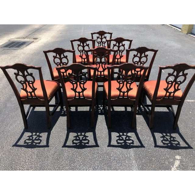 Absolutely fantastic set of 10 solid wood Chippendale style dining chairs. They offer quality craftsmanship and beautiful...