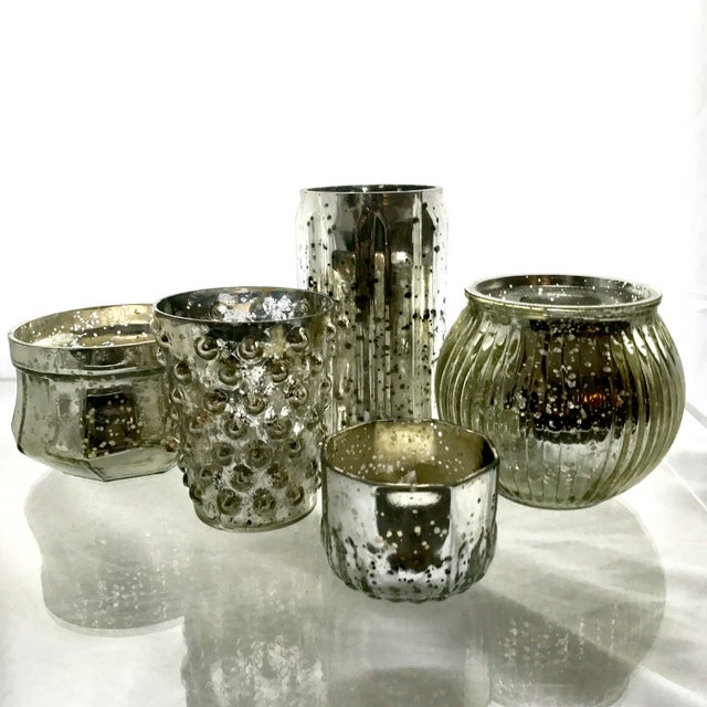 A lot of mix and match mercury glass votives. Tall, short, big small. Creates a beautiful collection.