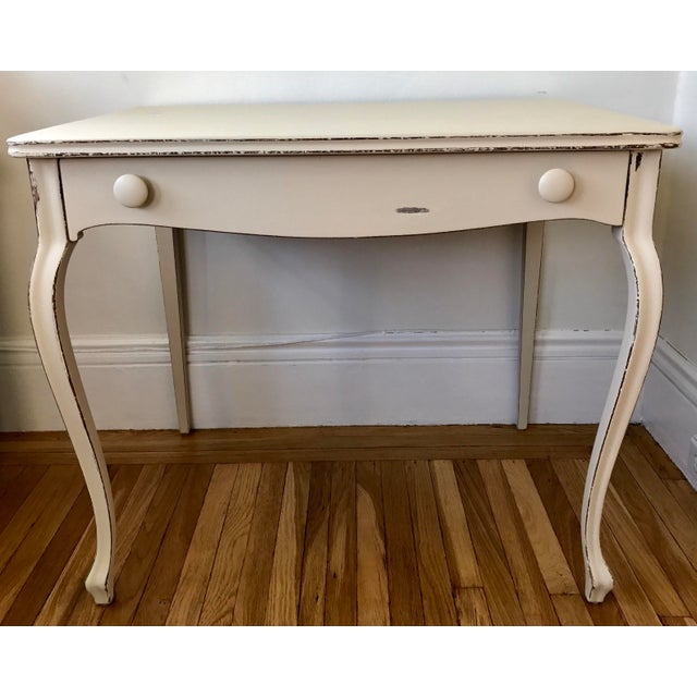 Charming vintage writing desk by the famous Berkey & Gay Furniture. Solid wood painted white with distressing on edges and...