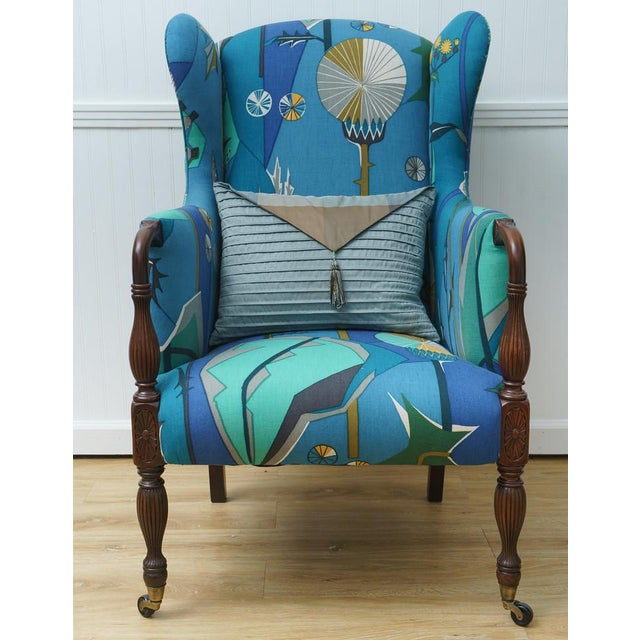 Classic and unique design. This chair has been recently restored and features new upholstery work done in quality fabric...