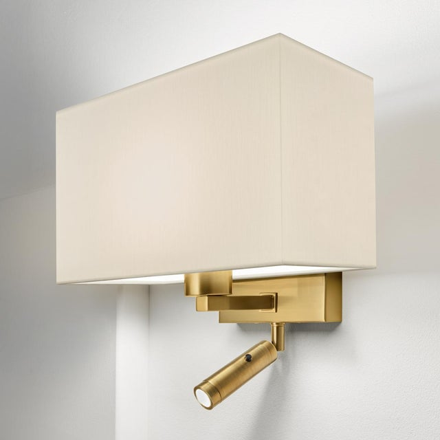 A brushed brass combination wall light with LED reading light with separate on/off button. Certification: IP20. Bulb: 1 x...