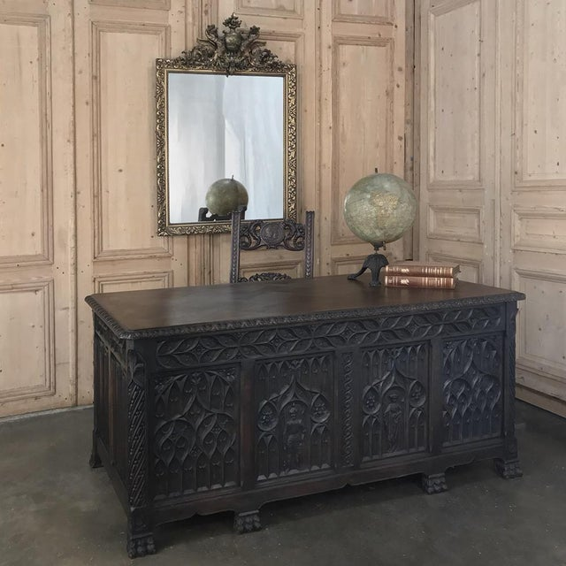 Antique French Gothic Parquet Top Desk was hand-crafted in the timeless style that dates back to the 12th century from...