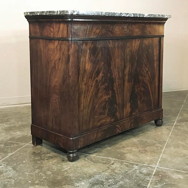 19th Century French Charles X Mahogany Marble Top Buffet represents the essence of the style, with exquisite flame...