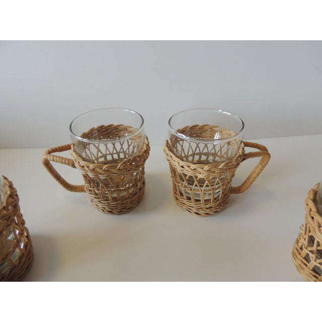 Set of Four (4) Woven Rattan Holders Drinking Glasses Rattan and glass Size: 4 x 3 x 2.5