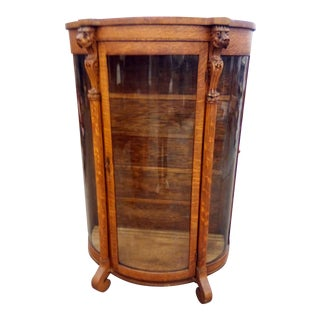 Antique Curved Glass Lion Head Cabinet For Sale