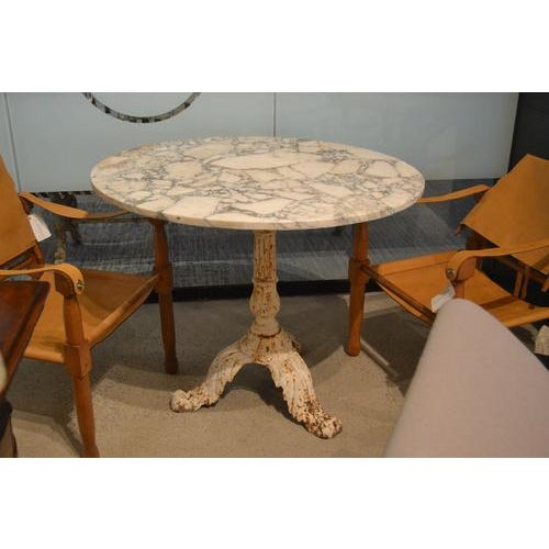 Beautiful 19th Century marble Gueridon table from France. Features a robust cast iron base and exquisitely grained marble...