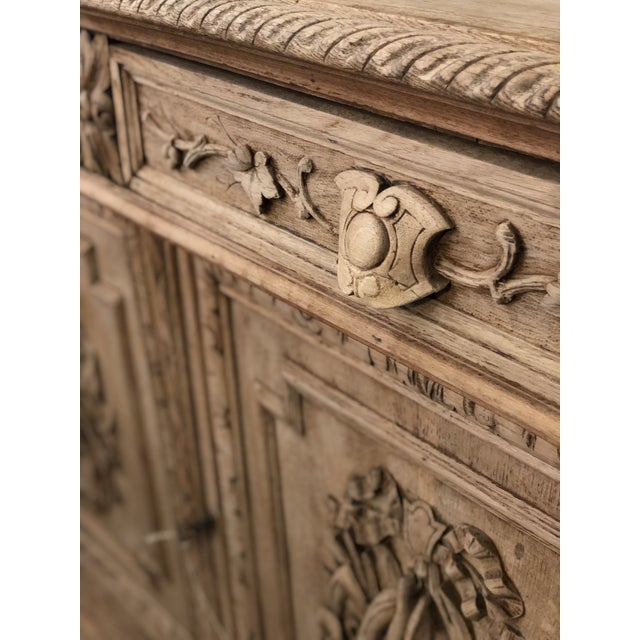French Louis XIII stripped oak hunt cabinet with barley twist columns and beautifully carved game, pheasant, and fish. Two...