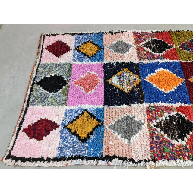 Authnetic Moroccan boucherouite style rug is a colorful and unique textile with handmade charm. Boucherouite is a...