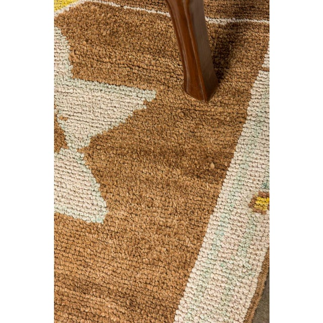 Add a little warmth to your living room, dining room, or bedroom with this gorgeous Turkish rug. This brown rug will fit...
