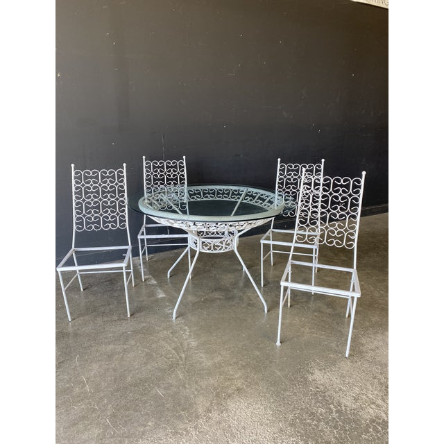 Great mid century patio set. Made very well of solid iron. Needs some TLC. The glass and metal shows wear. One of the...