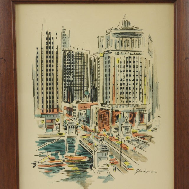 A framed print of a watercolor and ink painting by artist John Haymson. The print depicts Chicago's Boulevard Bridge with...