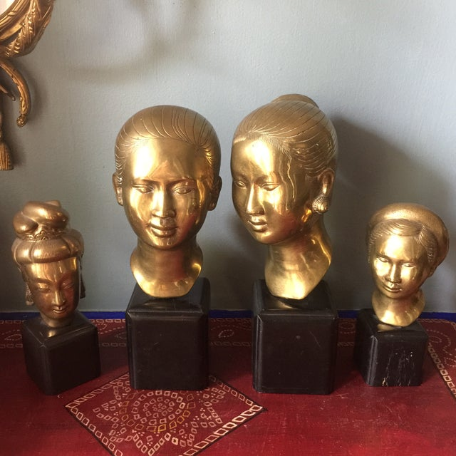 "Gorgeous collection of four Asian female sculptures with various arrangements. Signed H.L. 11"" x4"" 10.75""x4 7.5""x3"" 8"" x2.5"""