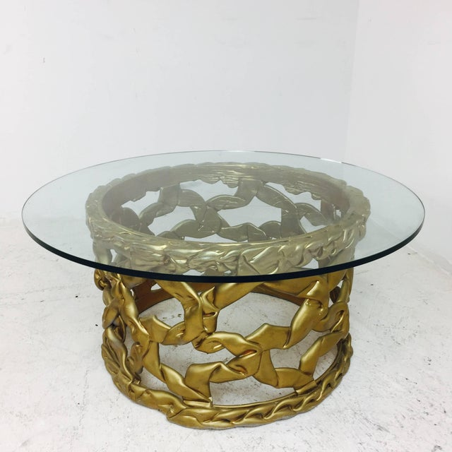 """Ribbon"" coffee table in gold resin in the Style of Tony Duquette. There is some visible wear due to age and use, circa..."