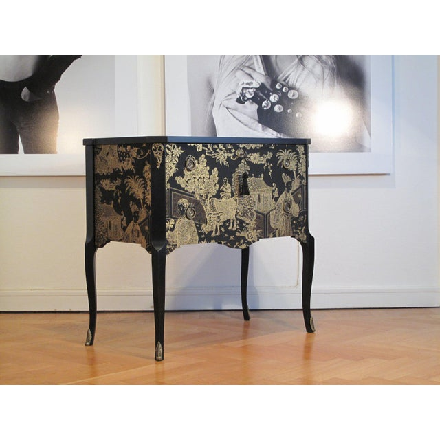 Antique Louis XV style commode from France renovated to the highest standard with a matte black finish and a new gold leaf...