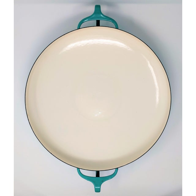 1950s turqouise Kobenstyle IHQ enameled metal paella pan, designed by Jens Quistgaard for Dansk. This is a very early...