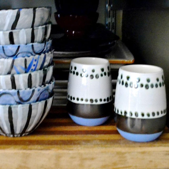 Stemless ceramic beverage mugs, hand painted by artists at Envision Unlimited.