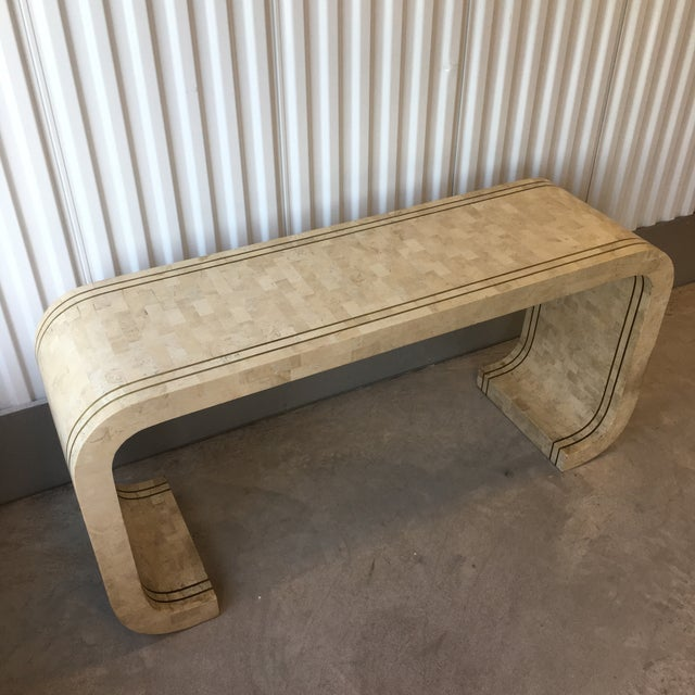 Stunning vintage circa 1980s Maitland Smith tessellated stone with brass inlay waterfall table. Great vintage condition...