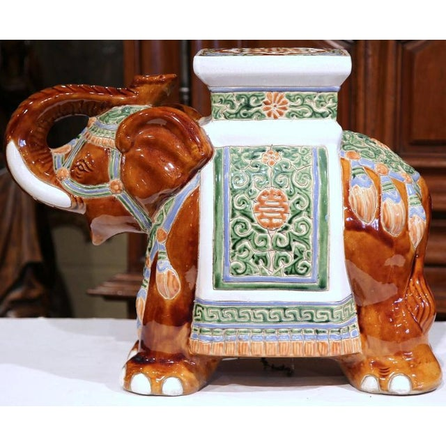 This interesting, porcelain garden seat was sculpted in France, circa 1920. The piece is in the shape of an elephant...